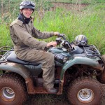 Sitting on an ATV by the banks of the Nile in Jinja, Uganda
